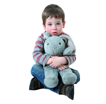 Sad child hugging a stuffed animal