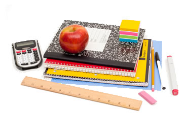 School supplies with an apple sitting on top